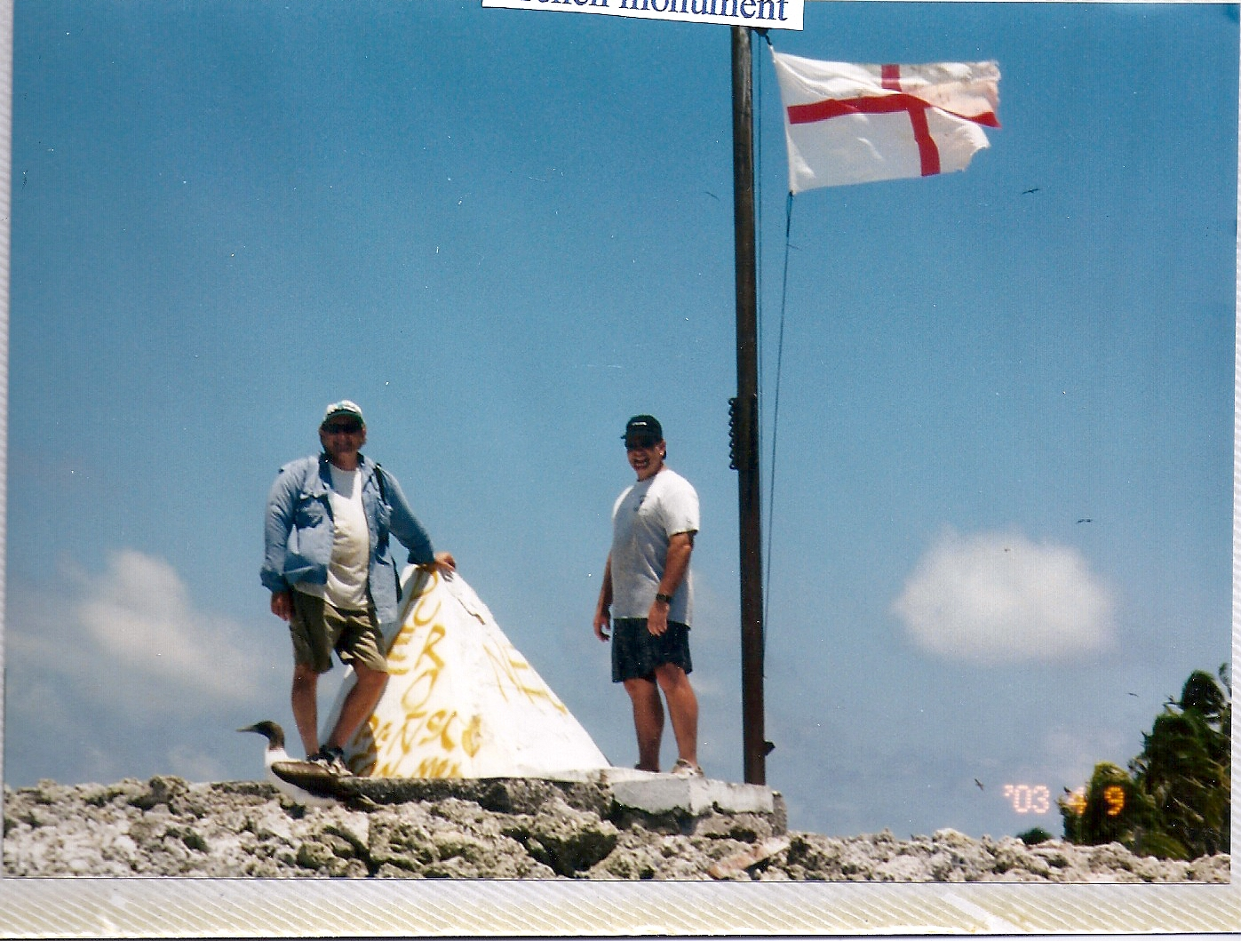Jeff and Greg posing with French Flag on Clipperton Atoll.jpg