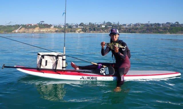 Michelle Bowman SUP fishing