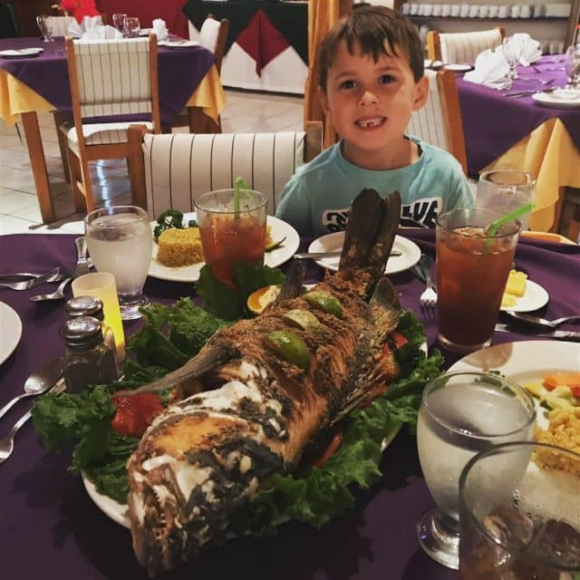 Henry with a whole fried fish