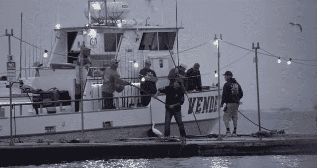 Scooping live bait from Everingham Bros. Bait Barge