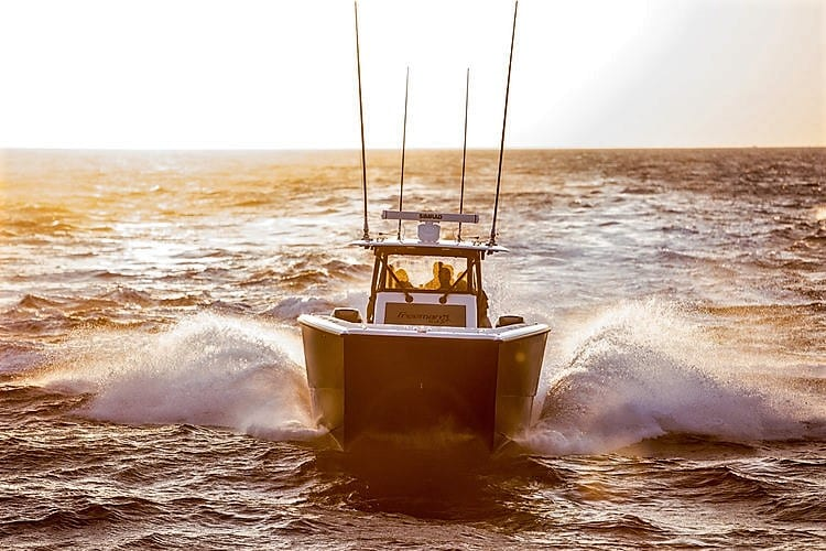 Freeman 42 LR Center Console Running Sunset